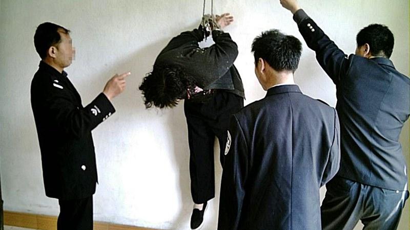 мъчение изтезание Фалун Гонг Китай
